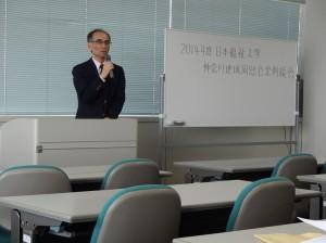 活動報告を行う神奈川県地域同窓会の片倉会長